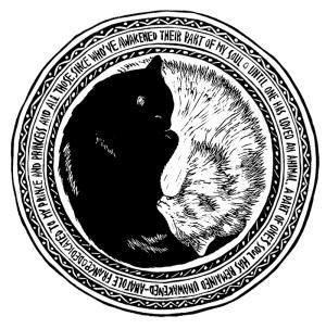 image of block print of black cat and white cat