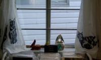 photo of curtains and ceramics