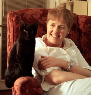 photo of black cat and woman