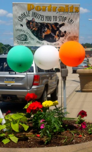 sign with balloons and flowers