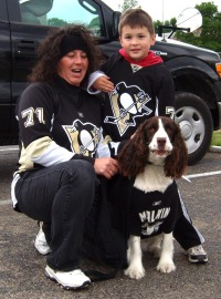 photo of penguins fans with dog