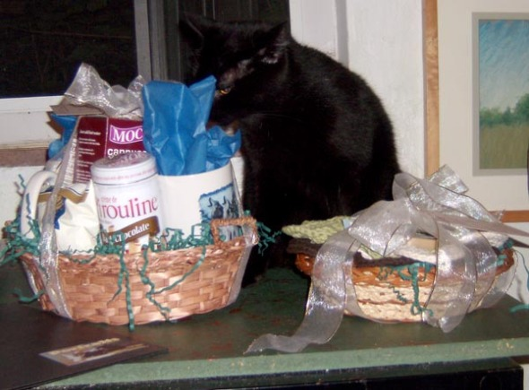black cat with baskets of gifts