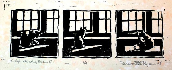 block print of cat in front of window