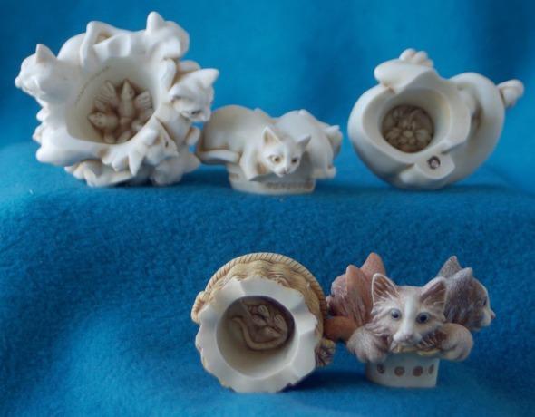 inside cat figurines