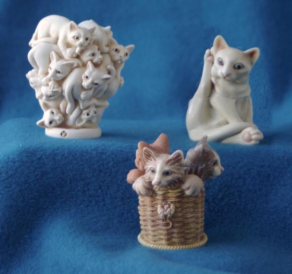 three cat figurines