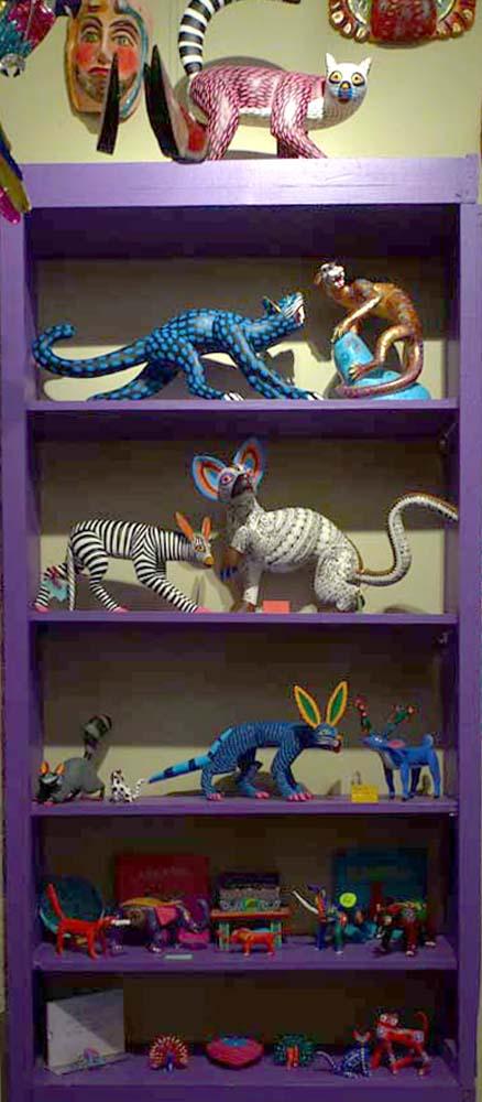 purple shelf with alebrijes