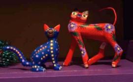 two feline alebrijes
