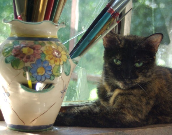 tortie cat with paintbrushes