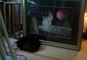 black cat with painting