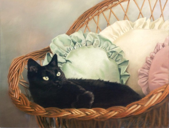 portrait of black cat in wicker chair