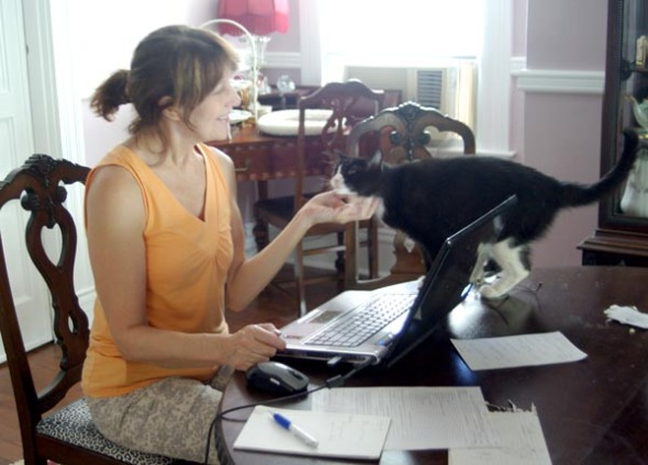 woman on computer with cat
