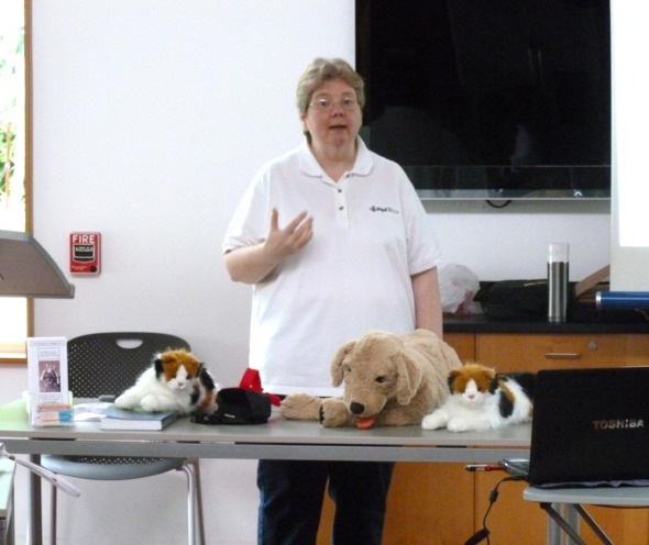 Karen Sable with cat and dog models.