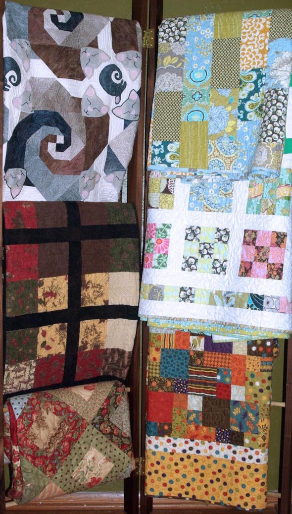 rack of quilts