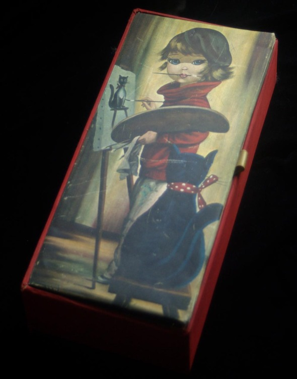 notions box with little girl artist and black cat