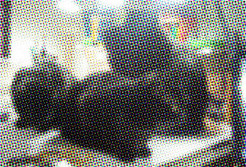 coarse color halftone of four black cats