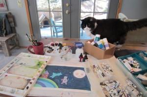 artist's studio with cat