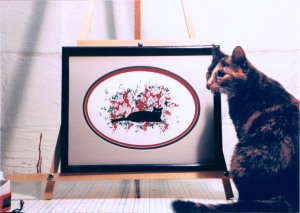 tortie cat with painting