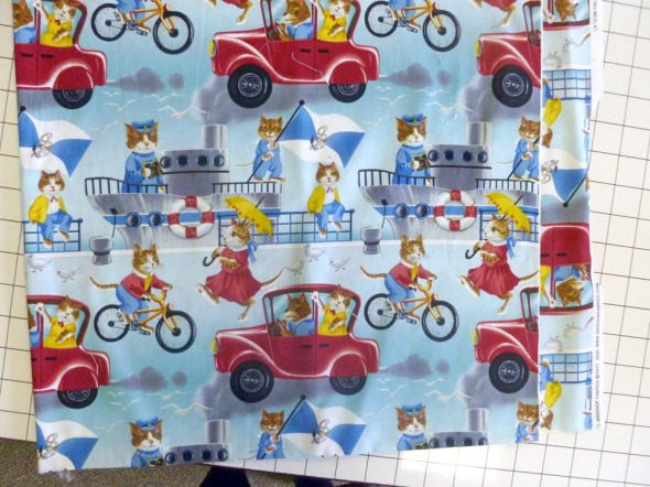 """Cats on Vacation"" by Andover Fabrics."