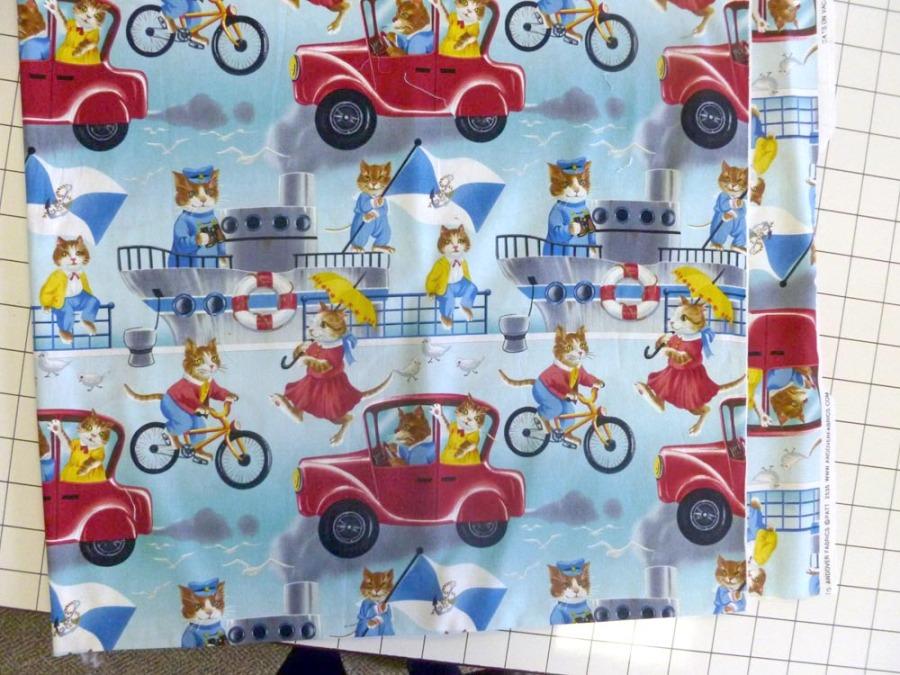 """Cats on Vacation"" by Andover Fabrics."