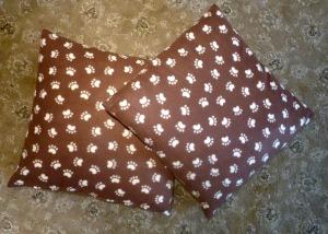 set of pawprint pillows