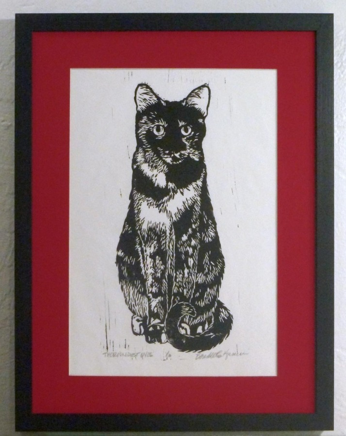 block print in black ink with red mat