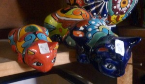 two painted cat sculptures